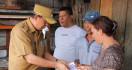 Bupati Royke: Berhati-hatilah, Cek Keadaan Rumah - JPNN.com